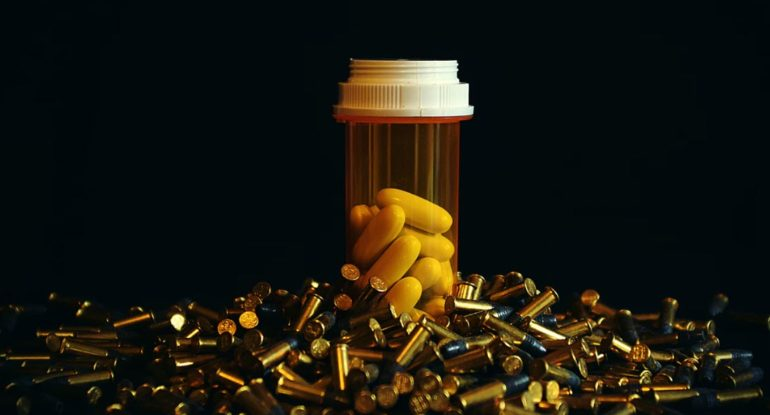 pills in a bottle create opioid crisis